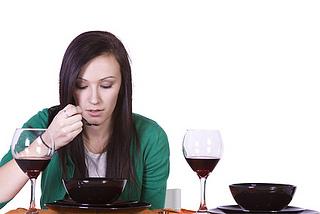 Beautiful Woman Eating Dinner Alone